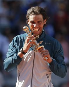 Rafael Nadal from Spain holds the trophy during the awards ceremony after winning the final of the Madrid Open tennis tournament against Stanislas Wawrinka from Switzerland, in Madrid Sunday, May 12, 2013. (AP Photo/Andres Kudacki) Next