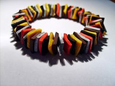 FIMOCHIPS  Stretcharmband: rot, braun, schwarz, gelb