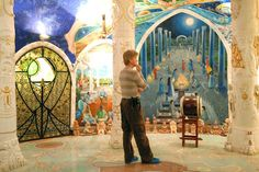 Pondering the meaning of ritual in the Hall of Earth, upper chamber, in the Temples of Humankind at Damanhur Spiritual EcoCommunity.