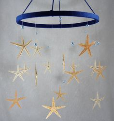 Sea stars baby mobile. I love this for a nautical theme.