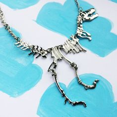 T-Rex, Jurassic World, Statement Necklace, Dinosaur Skeleton, Geeky Necklace, Geeky Gifts, Jurassic Park    Fans of films like Jurassic Park, Ice Age, Journey to the Center of the Earth and King Kong might enjoy this T-Rex inspired statement necklace brought to you from GYGO BOUTIQUE.      Sizes:    From head to toe: 14cm  Chain: 20cm      GYGO is an emerging geek brand specializing in bespoke jewelry and clothing inspired by and drawing on film, tv, comics, art, gaming and pop culture…