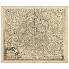 A detailed map of a region in eastern Germany. Cartouches depict coat of arms surrounded by cherubs. The map is fully engraved with towns, political boundaries, rivers and forests. Published by F.