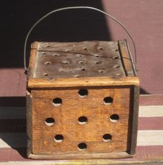 19th C Wooden Footwarmer - Oak frame in old attic surface with punched tin top. Front lid slides up to reveal the coal pan
