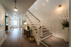 Traditional Staircase with Pendant Light, Hardwood floors, High ceiling