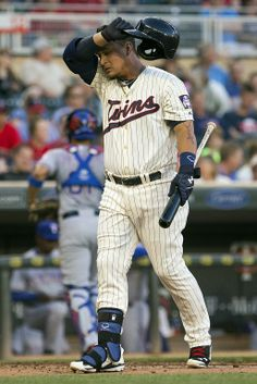 May 28, 2014; Minneapolis, MN, USA; Minnesota Twins right fielder Oswaldo Arcia (31) walks back to the dug out after striking out in the first inning against the Texas Rangers at Target Field. Mandatory Credit: Jesse Johnson-USA TODAY Sports