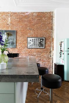 vtwonen home tour with brick walls and mint green smeg refrigerator / sfgirlbybay