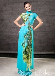 Beautiful dress inspire by the peacocks the most pretty bird in the world :) / Ao Dai Cach Tan - CT608 - http://aodaihoanguyen.com/ao-dai/ao-dai-cach-dieu/chi-tiet/3706-ao-dai-cach-dieu-ct608#.UJaqmIZKY80