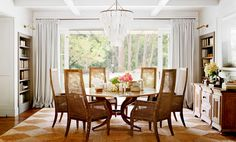 One of the most attainable ways to giving your dining room a polished look is to lay an area rug beneath your dining table. Many people overlook it, or are intimidated by the idea, but it's a finishing touch that will pull your room together.