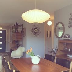 Finally found the perfect light for our dining room!  I'm loving the diffused light and sleek lines!  George Nelson Bubble Lamp - medium Saucer light hanging over our dining room table.  Brilliant design!