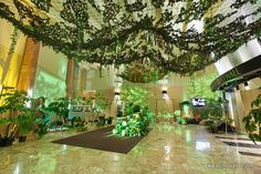 Annual Gala themed WILD, with safari look and feel, deep jungle, tropical and rainforest elements