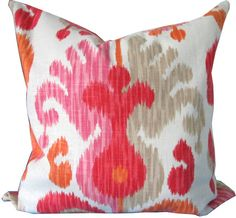 One decorative pillow cover Ikat pillow cover with shades of coral, soft red, dark pink, tangerine, natural and ivory Same fabric is used on both sides
