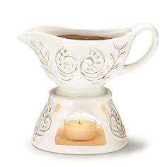 "Regularly $14.99 Sale $9.99Keep sauces warm during dinner with tealight stand (candle not included). Holds up to 8 oz. Hand wash. Two pieces together, approx. 8"" H x 5"" L x 4"" W. Ceramic. Imported.While supplies last."