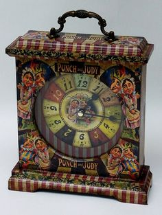 Punch and Judy Clock. Unusual Clock. Special Clock. Unique Clock. Nursery Clock. Punch and Judy. Carriage Clock. Mantel Clock. Clock. by ThePoshGoat on Etsy https://www.etsy.com/listing/525859608/punch-and-judy-clock-unusual-clock