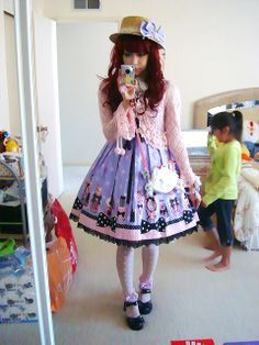 I think the dress is Angelic Pretty Fantastic Dolly OP.