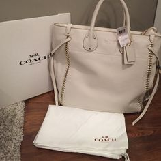 "SPECIALCoach Whiplash Tatum Tote Coach Whiplash Tatum ❣Genuine leather in chalk white with light gold hardware❣Whiplash leather/chain seams. ❣Zippered top that stays on runner when unzipped❣Double leather handles with drop of 5 inches❣16 1/2"" (L) x 14 1/2"" (H) x 4 3/4"" (W). ❣Color: Light Gold/Chalk Unfortunately I purchased it and it had wear on the handles which I've taken accounted for in the price(4th pic).. it's not really noticeableALL Reasonable offers considered  NO TRADESComes W…"