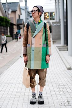 Japanese man in Harajuku wearing a coat with square pattern - i want that coat!