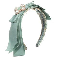 Elaborate, turquoise blue and gold jacquard hairband designed by Quis Quis. It has a large, grosgrain bow with a central turquoise jewel, surrounded by lovely pearl beads and diamanté.