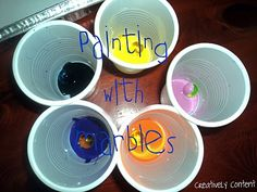 Painting with marbles! Kids love it and it is soooo simple.