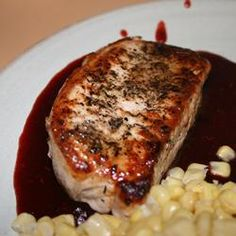 Pork Chops with Raspberry Sauce Recipe - Succulent herbed boneless pork loin chops paired with a tangy raspberry sauce ... heaven on a plate! This is a special family dish or perfect for company. I accompanied it with mashed potatoes and julienned steamed carrots. My husband cant wait to have it again.