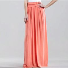 Robert Rodriguez Must-Have maxi skirt. Coral jersey. Wide fold-over waistband. Pleated column style. Hem falls to floor. Rayon/polyester. Made in USA. Available at Neiman Marcus