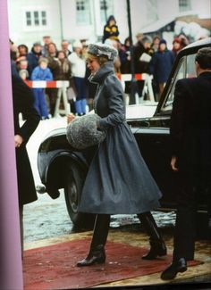 Princess Diana, who famously teamed her hand muff with a sleek equestrian style coat.