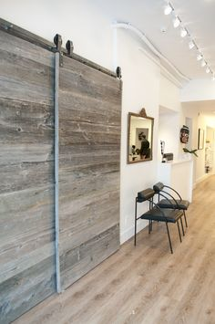 These bypassing barn doors covers a nook right in front of the store that houses electrical panels. Now they are the center of attention!