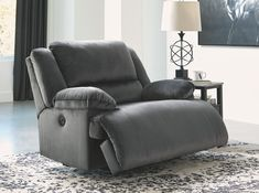 Large-scale comfort is yours with the Clonmel zero wall wide seat recliner. With supremely padded back. seat and arm cushions. it& the hero for ultimate relaxation. Microfiber upholstery is welcoming. soft and luxuriously covers the extra-wide se. Reclining Sectional With Chaise, Oversized Recliner, Furniture Direct, Modern Furniture, Power Recliners, At Home Store, Seat Cushions, Love Seat, Upholstery