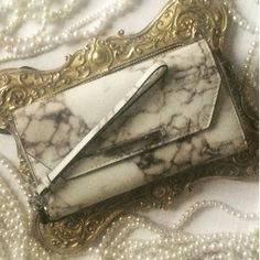 Rebecca Minkoff Marble Wallet/Wristlet/Phone Case Authentic. Never used. Six credit card slots, a large open slot for cash, a zippered coin pouch, phone slot and a snap closure front pouch. Removable wristlet strap. My iPhone 5S has a bulky Mophie case and fits in the wristlet/wallet without a problem. Measures approx. 8in x 5in x 1.5in. Rebecca Minkoff Accessories