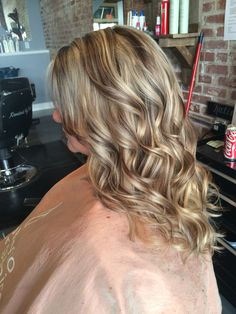 Blonde highlight with warm brown lowlights. Chunky. Long layered haircut. Curls #aloxxi  #kreationsbykatie