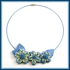 Jolion  Necklace Blue Felt Flowers by Jolion., via Flickr