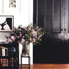 black doors, brass hardware, lilacs