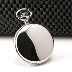 SS Quartz Pocket Watch 3551: This is Mirror finish all stainless steel pocket watch by Charles-Hubert. Case diameter is 1.87 inches and width is .47 inches. Weight is 2.1 ounces. Can be personalized on the front cover or back case. Comes with a chain and gift box.