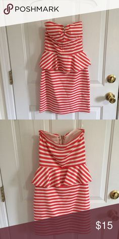 Strapless red and white striped peplum dress Strapless red and white striped peplum dress. Red is an orangey red, cups are padded, the zipper works, the skirt is not see-through. There is some light pilling. I'll try to find a picture of me wearing it! Poof Dresses Strapless