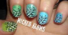 Blue to green gradient over nails with B+W stamps. Love it!