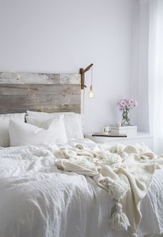 bedroom: timber headboard, white on white linen + hanging light