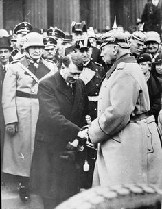 Adolf Hitler greets Marshal Paul von Hindenburg, the German President, at a ceremony in Berlin in early 1934, after Hitler's appointment as Chancellor in 1933. Behind Hitler are Joseph Goebbels, Herman Goering, SS General Sepp Dietrich and Admiral Erich Raeder.