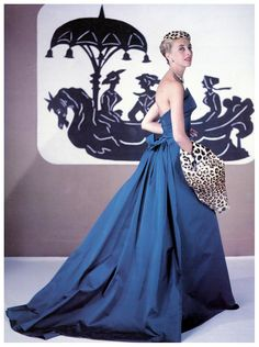 Balmain mannequin Marie-Thérèse models his evening gown accented with leopard hat and muff, photo by Philippe Pottier, 1953