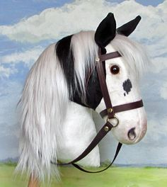Attractive piebald hobby horse in the larger size.
