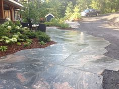 granite driveway at entrance of lakeside home in Muskoka