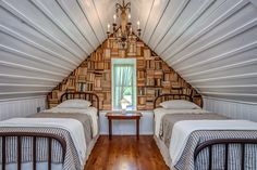 The upstairs loft sleeps two, with matching twin beds. Its wall of stacked books gives the room a dramatic focal point.