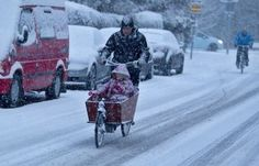 Dutch family out for a pedal. Cars maybe snowed in but not bikes!