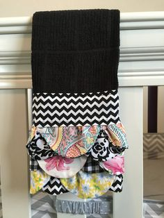 This is a beautiful black ruffled tea towel. It has 3 rows of ruffles with each row featuring 6 different fabric designs making it truly unique and special. The towel is 100% cotton and is durable and washable. Makes for a lovely addition to any kitchen or bath. They make wonderful gifts to yourself, or any special someone. Wonderful ideas for Mothers Day, birthdays, housewarming, bridal showers, holidays. Great for any occasion you can think of!!  Measures 17 wide and 27 length.    Purchase…