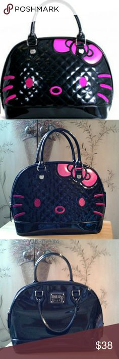 Loungefly Hello kitty embossed  bag In great condition  no stains,no rips, no discoloration, bought for work but was not allowed  due to dress  code so it was used twice . PRICE IS FIRM  i know these sell for much more on eBay  Its a pretty  big spacious  bag its not Small a lot can fit inside  Love this purse but it is not practical for my daily work and school life. Hello Kitty Bags Totes