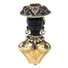 Beautiful carved black Obsidian Blackamoor pendant, 14K yellow gold engraved body, earrings and headdress; body enhanced with gold bead diamond and teardrop garnet set necklace, silver and gold headdress embellished with assorted gemstones; acid tested to 14k.