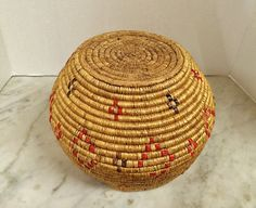 Where can you buy a VINTAGE WASHINGTON SALISH RED and BROWN IMBRICATED ROUND BASKET? Here and its a BEAUTY! This round basket shape is PERFECTION and very pleasing to the eye. Its decorated with 24 small cross shapes and 8 diamond stepped, geometric shapes done in imbricated red and brown horsetail reed. The red on the imbrication is very vivid and colorful as you can see.  https://www.etsy.com/listing/507787517 $225.00.