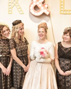 These bridesmaids wore lace-overlay dresses, with old-timey pillbox hats to cap off their vintage looks