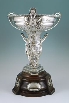 """The 1922 Grand National Trophy. Run at Aintree, won by """"Music Hall"""". March 24th 1922.   A solid sterling silver trophy on original wooden base. By Elkington & Co. Birmingham 1921"""