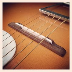 made a custom bridge to replace the monumentally huge plastic piece of rubbish that was on my Kansas guitar. dismantled a 2-piece adjustable mandolin bridge; gouged out a channel for a guitar bridge bone.