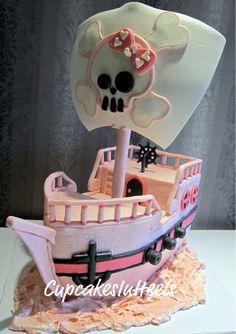 Girly pink pirate ship cake