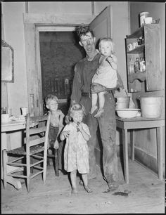 This image just breaks my heart. How hard the life and times for coal miners and their families? Would I have been strong enough to survive it? This is Dillard Eldridge and his children in the kitchen of the twenty year old four room house for which they pay $9 monthly. Kentucky Straight Creek Coal Company, Belva Mine, abandoned after explosion, Four Mile, Bell County, Kentucky. (Wikimedia Commons image - Department of the Interior. Solid Fuels Administration For War. (04/19/1943…